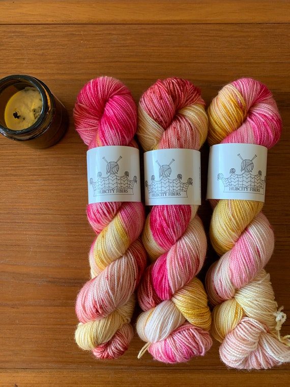 3 skeins and a 4 oz candle Fingering weight