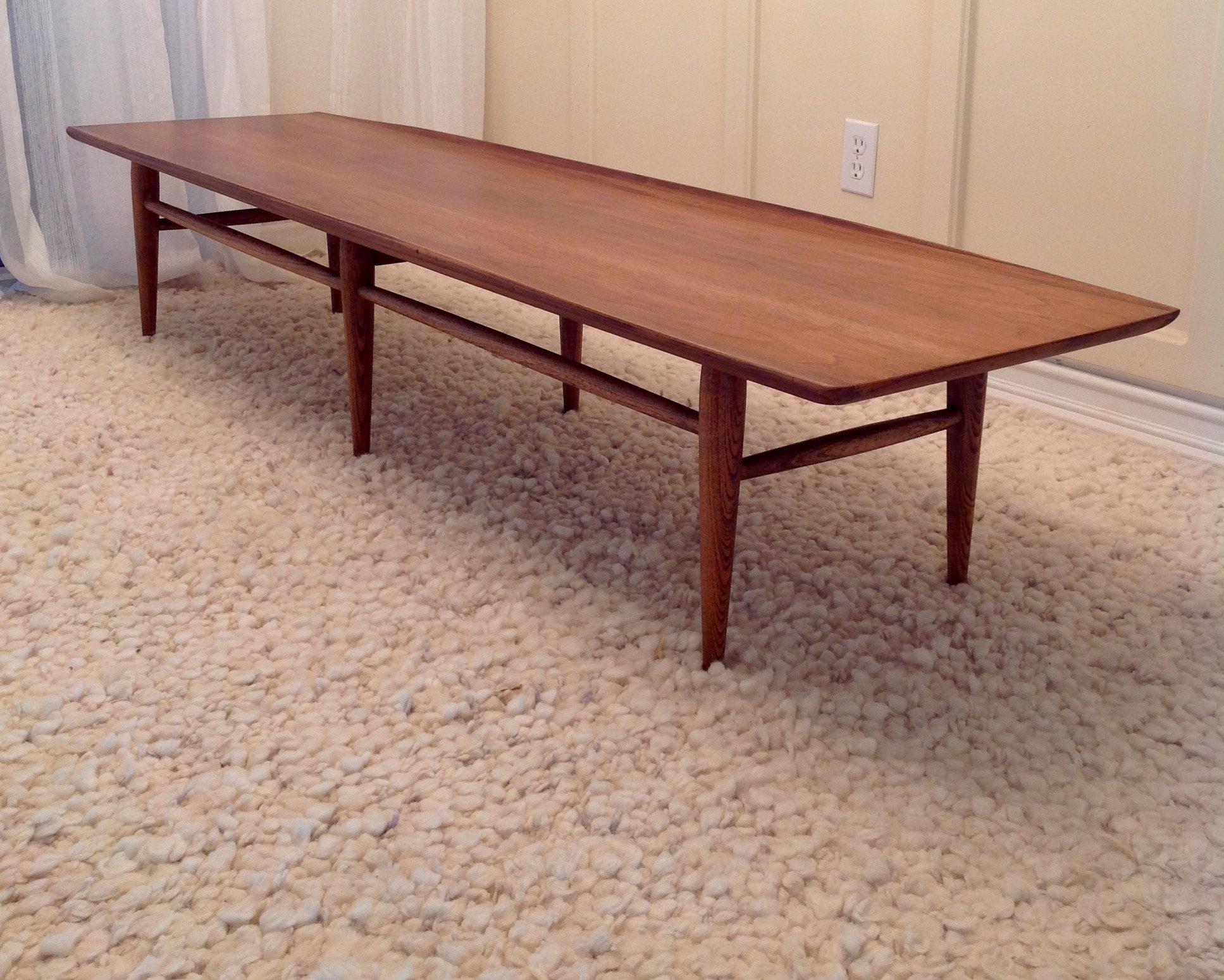 A Mid Century Modern Walnut Surfboard Coffee Table By Bassett