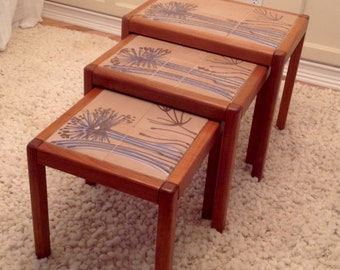A Set of Three Danish Teak with Tile Top Nesting Tables