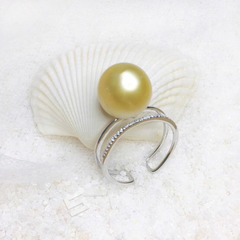 fc6b551a9144 135 MM oro anillo de la perla perla de auténtico oro del mar