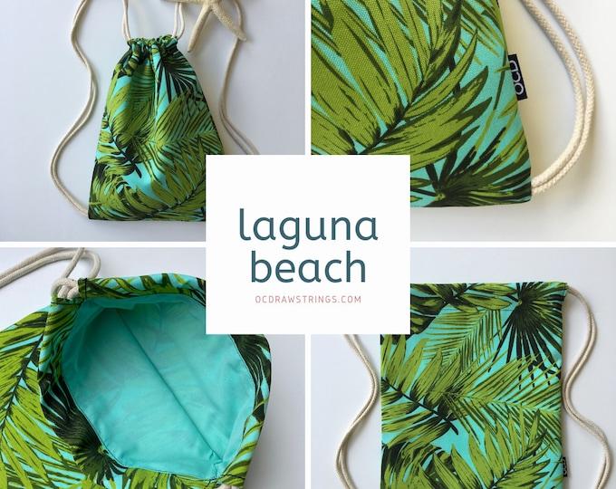Featured listing image: Laguna Beach Drawstring Backpack - Tropical OCD Bag - Small Cinch Sack - Palm Leaf Drawstring Purse - OCD Cinch Bag - OC Drawstrings