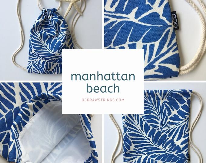 Featured listing image: Manhattan Beach Backpack - Blue Palm Leaf Drawstring Backpack - Small Cinch Sack - Tropical Beach Bag - Mini Drawstring Purse - OCD