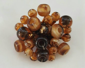 Unsigned brown glass beaded pin