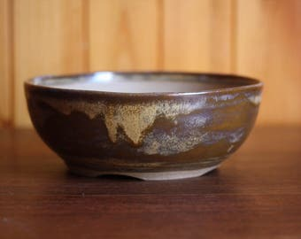 Handthrown bonsai pot glazed with a variegated brown glaze