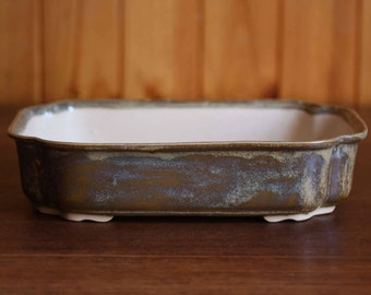 Scalloped bonsai pot with a variegated brown glaze