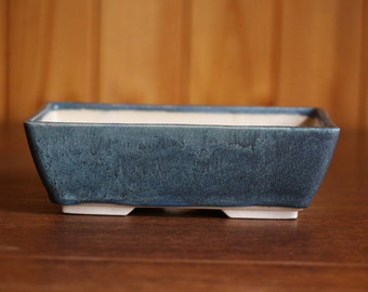 Shallow bonsai planter in a matte dark turquoise green glaze