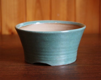 Round bonsai or succulent pot in a speckled duck-egg blue
