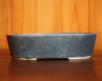 Hand slipcast bonsai pot with a matte blue green glaze
