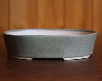 Oval bonsai pot in a matte olive green