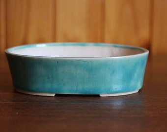 Oval bonsai pot in glossy aqua blue