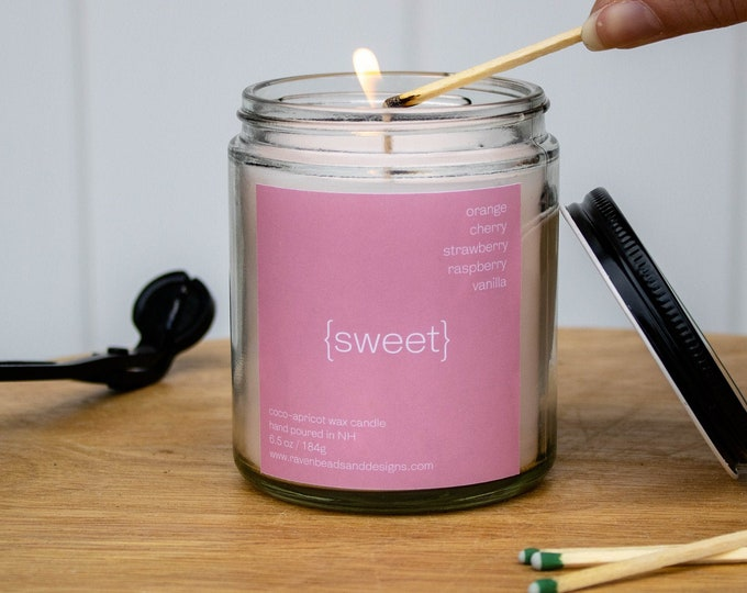 SWEET: juicy orange, berries, and vanilla scented candle