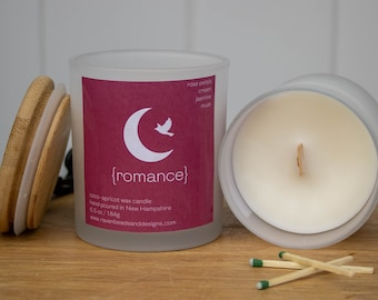 ROMANCE: rose petals, cream, jasmine, and musk scented wood wick candle