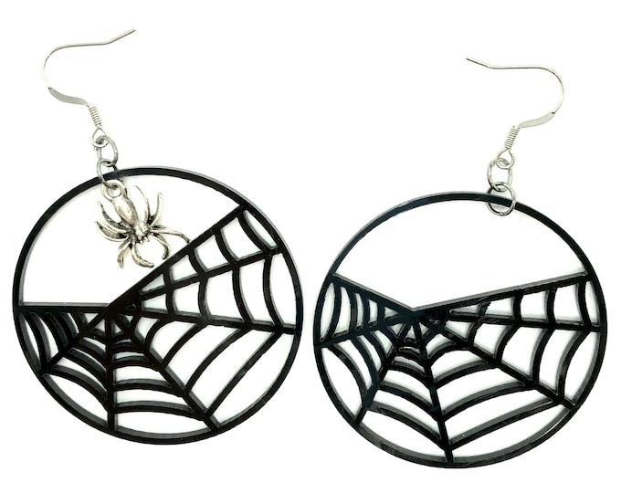 SPIDEY: large asymmetrical spiderweb earrings