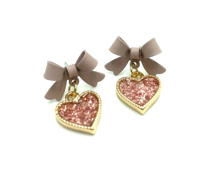 LARA: sparkly pink heart and bow studs