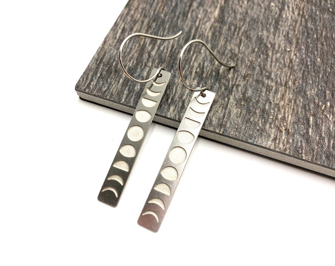 COSMO: etched moon phases earrings