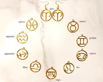 ASTRO: gold tone statement zodiac sign earrings