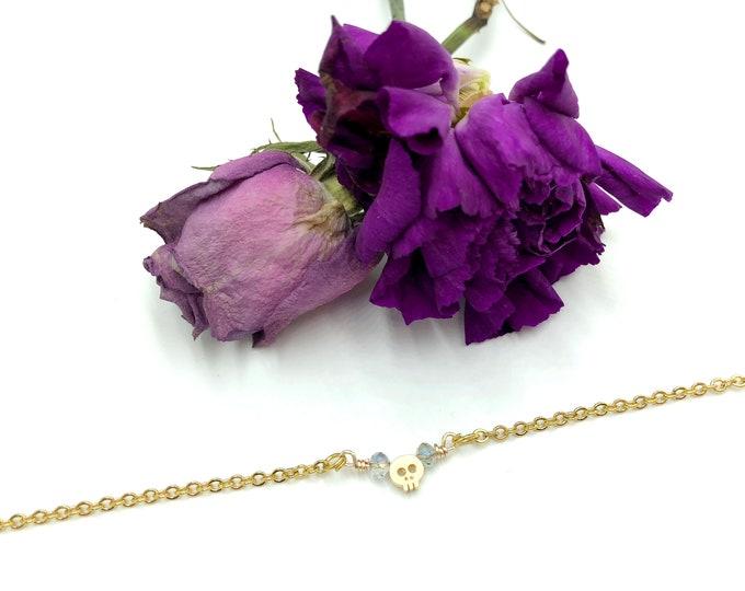 BONES: tiny gold skull necklace
