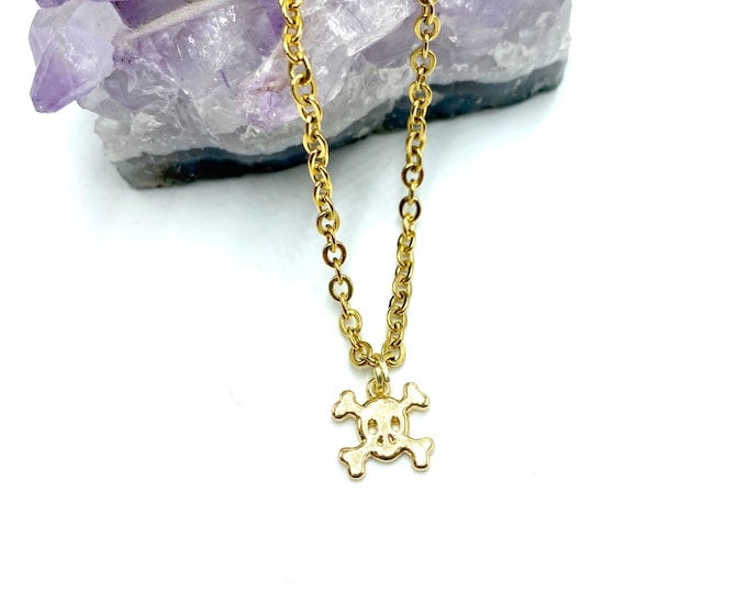 MINI BONES: delicate gold tiny skull necklace
