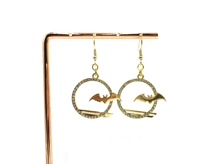 DARK SHADOWS: gold bat drop earrings