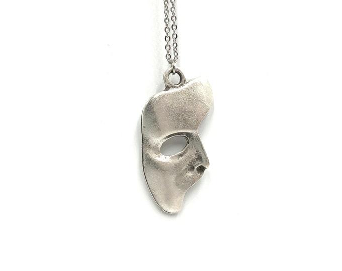 CHRISTINE: statement long mask necklace
