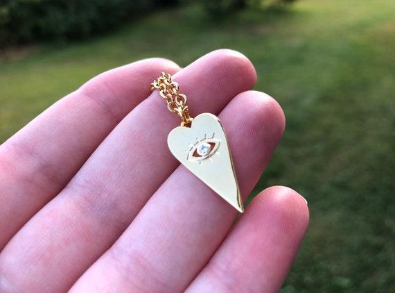 HEART EYE: heart cubic zirconia evil eye necklace