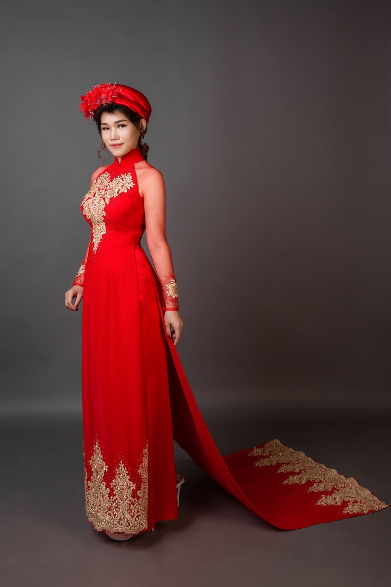 5e4c6a7dba3 Wedding ao dai with long train. Red with gold colored details.