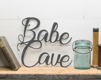 Babe Cave Metal Sign