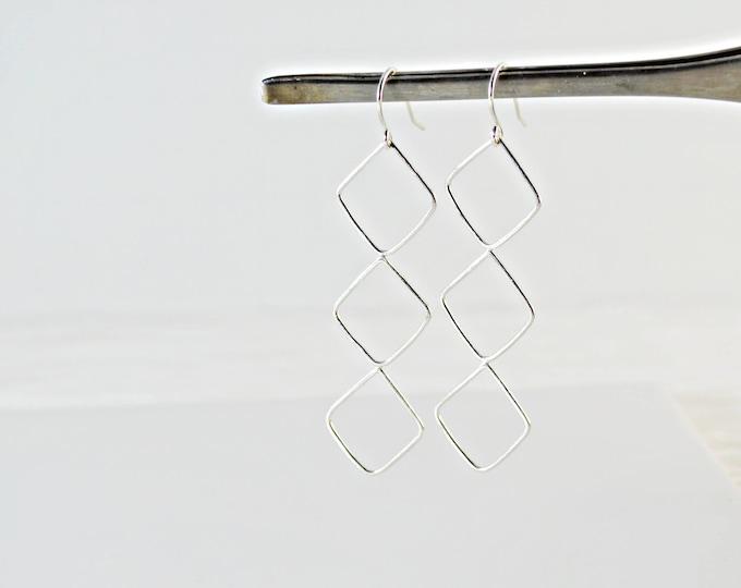 Long Silver Geometric Dangle Earrings by Lepa Jewelry