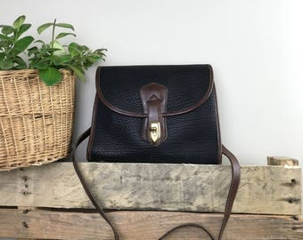 Authentic Vintage Dooney & Bourke Black Pebbled All Weather Leather Flap Closure Shoulder Bag with Brown Trim