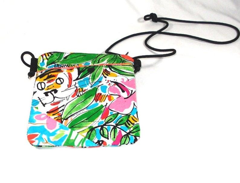 with zipper closure Peekaboo Tiger Crossbody Runaround Tote Bag #3 exterior pocket with hook-loop closure and adjustable paracord strap