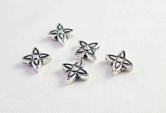 INT11 Shaped flowers stars obsolete money patterned spacer beads