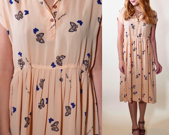 1970s vintage Hanai Mori pale pink semi sheer. butterfly print short sleeve collared shirt midi dress women's size Medium-Large
