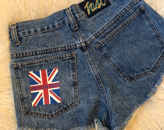"Vintage high waisted women's denim high waisted cut offs with 1970's ""British Rock"" pocket iron on transfer. size 2"