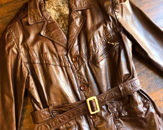 1960s-1970s authentic vintage dark brown leather belted trench coat with fur lining unisex size medium
