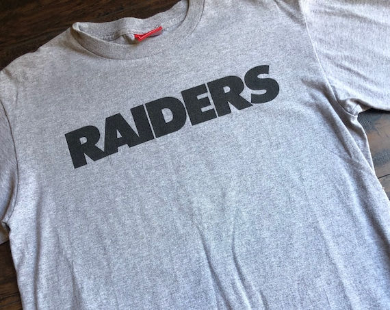Vintage Gray and black faded Oakland Raiders football logo graphic tee shirt unisex size medium