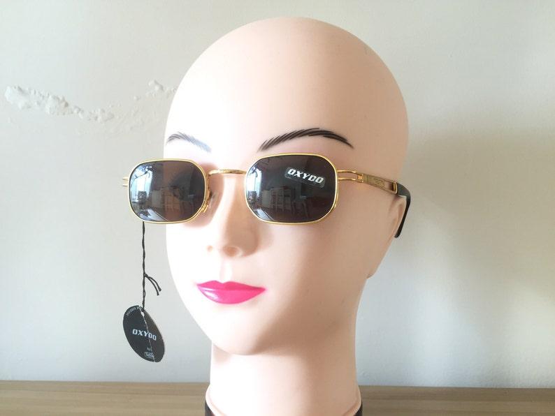 ae49484327ae Safilo Gold Sunglasses Small Rectangle sunglasses Vintage   Etsy