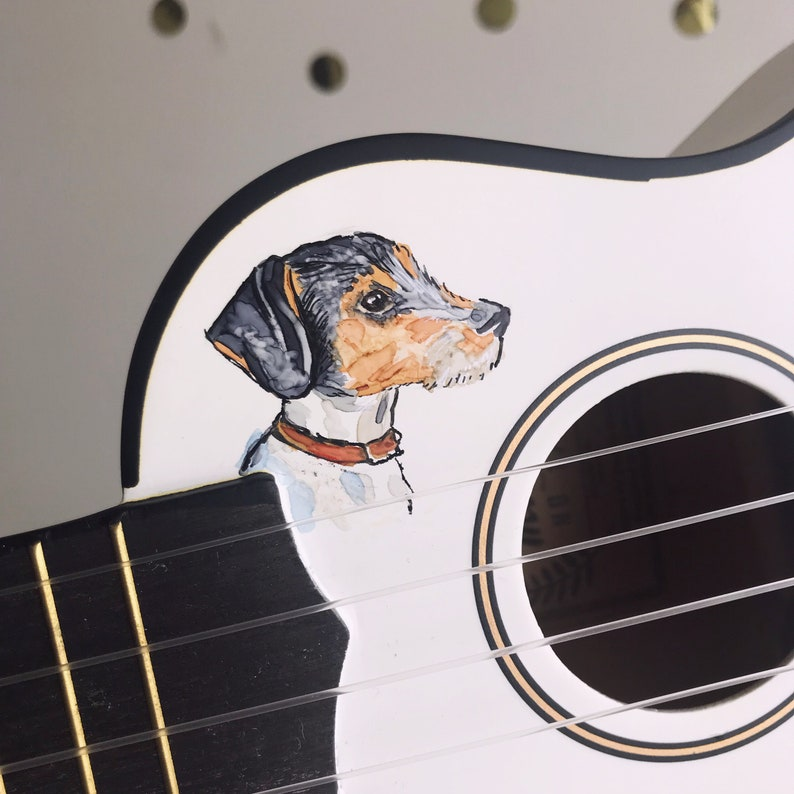 Dog watercolour portrait on a ukulele