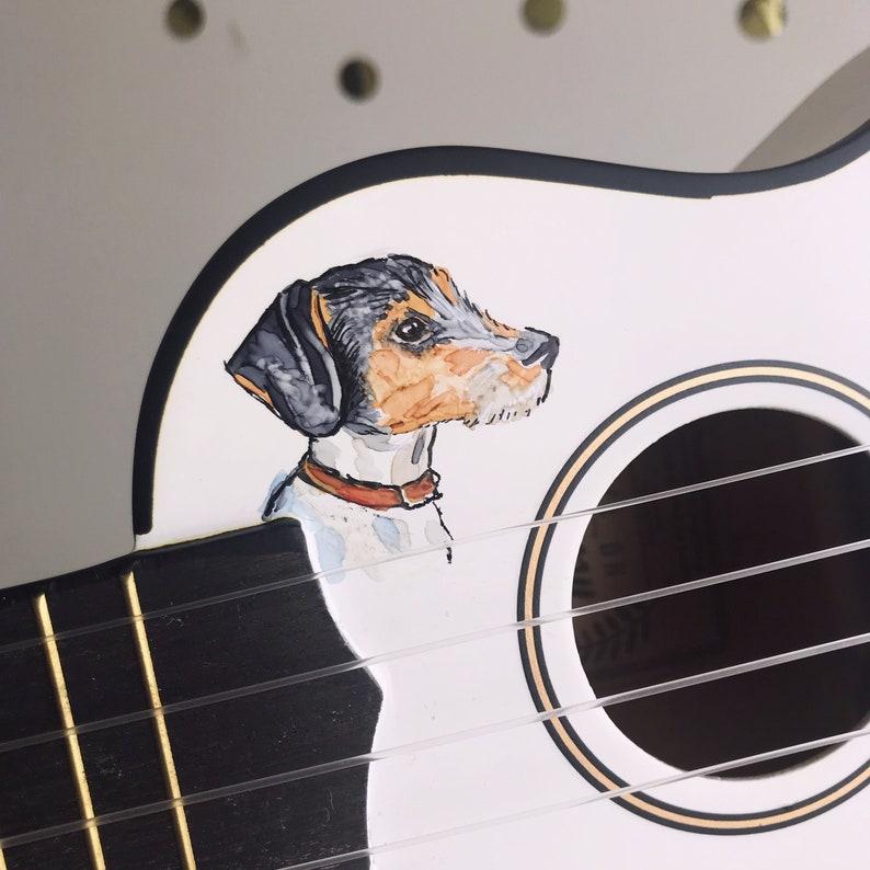 Dog watercolour portrait on a ukulele