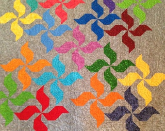 Gray and multi-colored pinwheel quilt