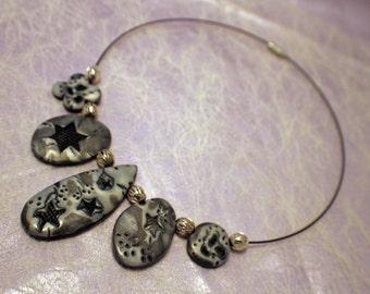 Beautiful three pendant, mokume gane, polymer clay necklace on rigid choker