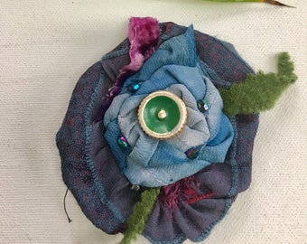 Flower brooch made of silk purple and green and gold handmade ceramic button