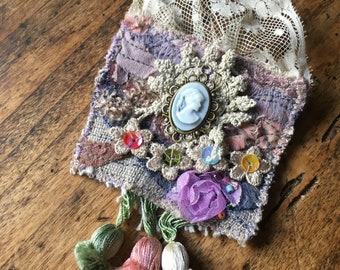 great textile art fabric cameo and lace vintage tassel brooch