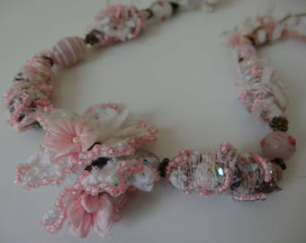 Necklace handmade fiber beads in shades of pink and white