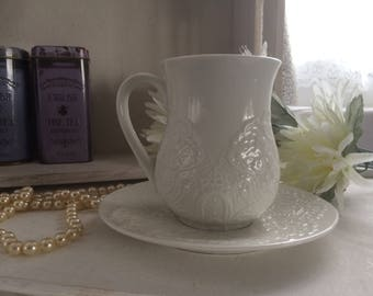 Ivory lace embossed ceramic mug with matching saucer