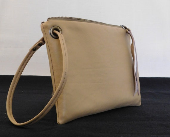 Tan recycled leather wrist clutch purse.
