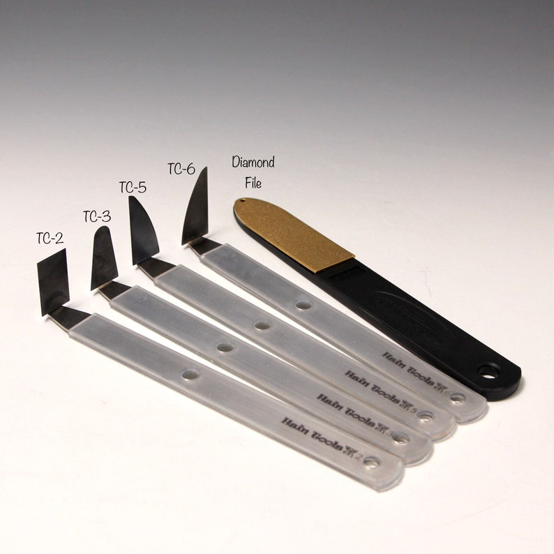 a diamond file~The Hardest TrimmingChatteringCurving Tools by Hsin-Chuen Lin A Set of 4 Tungsten Carbide \u00a9copy right #TXu 1-961-453