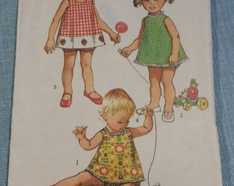 Vintage simplicity 9437 toddlers top with three necklines and bloomers.