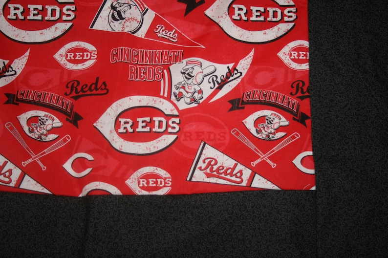 Cincinati Reds lap throw with flannel backing