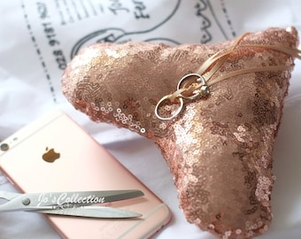 Rose gold sequinned wedding ring cushion in the shape of a heart