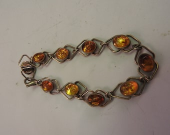 hallmarked 925,solid silver vintage bracelet with the amber stones
